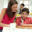 Parents Helping Children With Homework — Stock Video #71414313