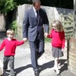 Father Walking To School With Children — Stock Video #71416091