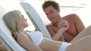Romantic Couple Relaxing On Loungers — Stock Video