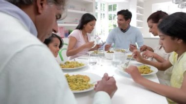 Multi Generation Indian Family Eating Meal — Stock Video