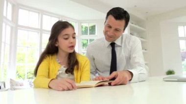 Father Helping Daughter With Homework — Stock Video