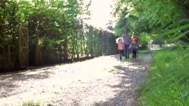 Family Walking In Summer Countryside — Stock Video