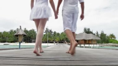 Couple Walking On Wooden Jetty — Stock Video