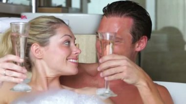 Couple toast one another with champagne — Stock video
