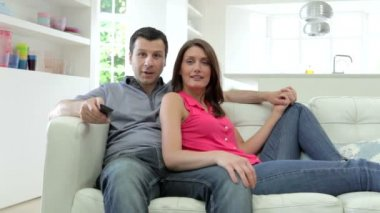 Hispanic Couple Sitting On Sofa — Stock Video