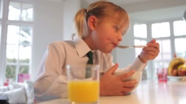 Little smiling girl having a breakfast — Vidéo