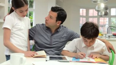 Father Helping Children With Homework — Stock Video