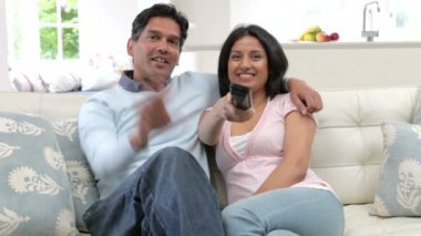 Indian Couple Sitting On Sofa — Stock Video