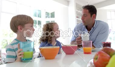 Father And Children Having Breakfast — Stock Video