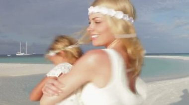 Bride as she spins bridesmaid around — Vídeo de stock