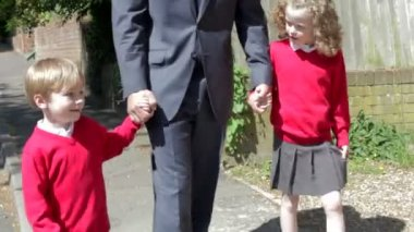 Father Walking To School With Children — Stock Video