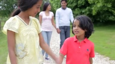 Indian Family Walking In Countryside — Stock Video