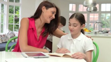 Mother Helping Children With Homework — Stock Video