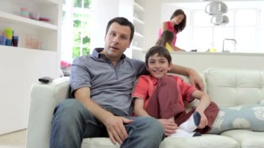 Hispanic Family Sitting On Sofa — Stock Video
