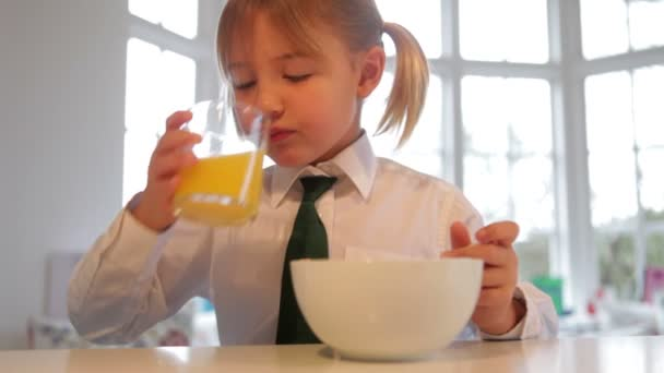 Little smiling girl having a breakfast — Vídeo de stock