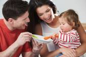 Parents Feeding Baby Daughter — Stock Photo