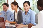 Businesspeople Meeting Around Boardroom Table — Stock Photo