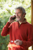 Mature Man Using Cordless Phone — Stock Photo