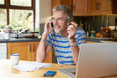 Mature Man  Looking At Home Finances — Stock Photo