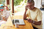 Mature Man Making On Line Purchase — Stock Photo