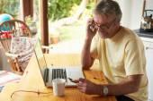 Mature Man Using Credit Card — Stock Photo