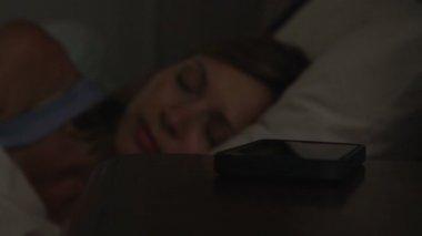 Woman Woken By Phone Message — Stock Video