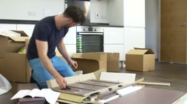 Man following furniture assembly instructions. — Stock Video