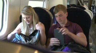 Teenage Couple On Train Journey — Stock Video