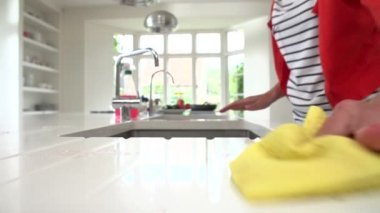 Woman Cleaning Surface In Kitchen — Stock Video