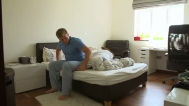Boy Getting Up And Ready In Bedroom — Stock Video