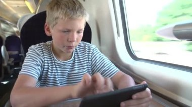 Boy Reading E Book On Train Journey — Stock Video