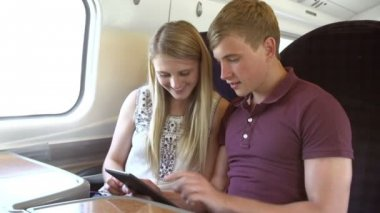 Couple Reading E Book On Train Journey — Stock Video