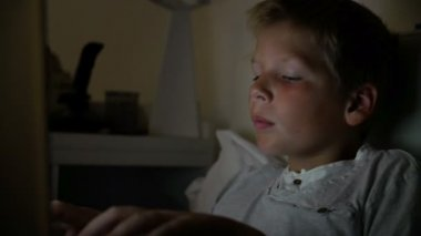 Boy Using Laptop At Night — Stock Video