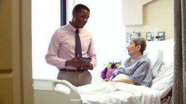 Consultant Talks To Senior Patient — Stock Video