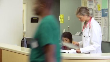 Staff Working At Nurses Station — Stock Video
