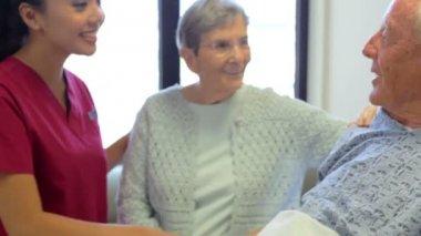 Nurse Talking To Senior Couple — Stock Video