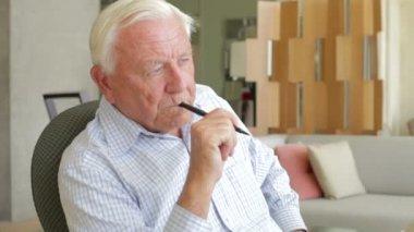 Senior Man Writing  At Desk — Stock Video