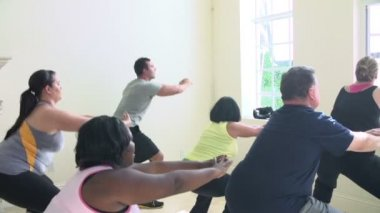 Fitness Instructor In Exercise Class For Overweight People — Stock Video
