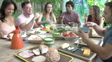 Group Of Friends Enjoying Meal Outdoors At Home — Stock Video