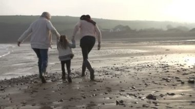 Grandmother, Mother And Daughter Walking Along Beach — Stock Video