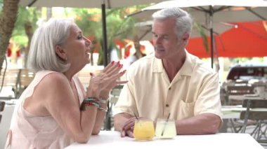 Senior Couple Enjoying Drink In Outdoor Cafe — Stock Video