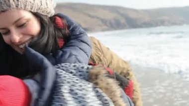 Mother And Daughter Playing On Winter Beach — Stock Video