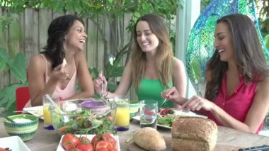 Three Female Friends Enjoying Meal Outdoors — Stock Video
