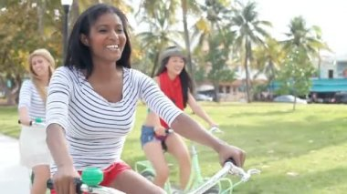 Female Friends Having Fun On Bicycle Ride — Stock Video