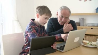Grandfather Using Laptop And Grandson — Stock Video