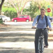 Woman cycling along street to work — Stock Video #72766347
