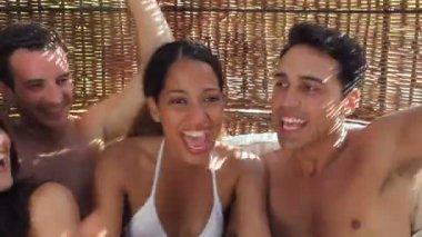 Friends dancing in rattan pavilion — Stock Video