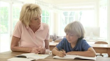 Grandmother Helping Grandson With Homework — Stock Video