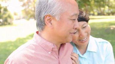 Senior Asian Couple in Park — Stock Video