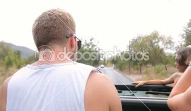 Young friends having fun in car — Stock Video
